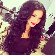 big brown/black hair, perfect curls, the perfect red lip, and awesome eye makeup.. She's just pretty.