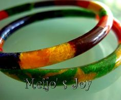 Crazy Summer Bangle...made from PVC aquarium tubing, filled with string, yarn, cloth, ribbon...and oil...then sealed closed into a bracelet. Fun!