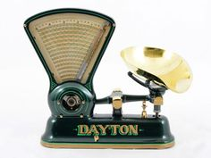 American 5 lb candy scale, style #167 in green with polished brass pan and accents by IBM Dayton Scale Division, circa 1910.