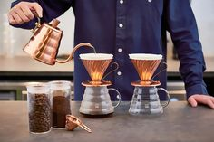 The post HARIO V60 Copper Coffee Drip Kettle Practical Capacity 700ml – Genuine Made in Japan appeared first on TAKASKI.COM. HARIO V60 Copper Buono Coffee Drip Kettle Practical capacity 700ml. Easy to pour, coffee drip kettle with a slim spout This drip kettle with a slim spout makes it easier to control the amount and speed of hot water being poured, making it useful when brewing a V60. Genuinely made in Japan. Easy to use, can be used directly on IH range, gas, or electric stoves.Be a p Drip Coffee, V60 Coffee, Coffee Drinks, Coffee Equipment, Cooking Equipment, Genmaicha Tea, Japanese Drinks, Sencha Tea, How To Make Coffee