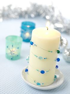 Set the mood with this gorgeous beaded candle and matching votive holders