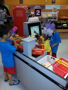 Fun at the Children's Museum of Houston in the Pretend HEB Grocery Store.