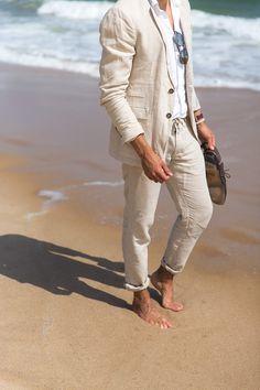 Beige two-piece linen menswear suit on Montauk beach