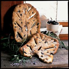Olive Fougasse was originally baked on the oven floor to create a crisp crust. Recipe: Olive Fougasse   - CountryLiving.com