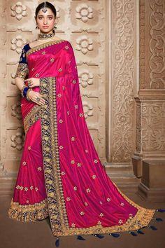 Deep Pink silk saree with dark blue banglori silk blouse, embellished with dori work, resham work, sequins, stone work and zari work. Saree with Round Neck, Half Sleeve. It comes with unstitch blouse, it can be stitched 32 to 58 sizes. #deep pink #silk #saree #blouse #Indiansaree #Andaazfashion #UK Designer Silk Sarees, Art Silk Sarees, Georgette Sarees, Bridal Sari, Saree Wedding, Wedding Wear, Fancy Sarees, Party Wear Sarees, Embroidery Saree