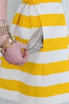 Cute yellow stripes! The grey pockets are a great touch, like a sunshower.