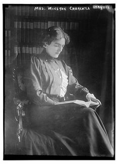Mrs. Winston Churchill seated with book