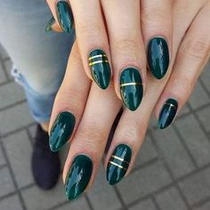 18 Green Manicures - Add some flair with gold striping tape.