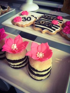 Amazing striped mini cakes at a black, white, pink and gold  birthday party! See more party ideas at CatchMyParty.com!