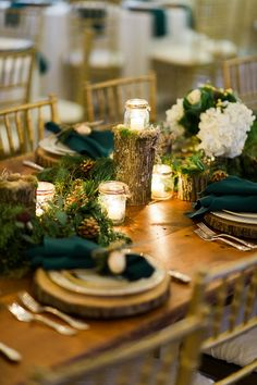 A Woodland Theme Wedding Center Piece With Candles At The Dairy Barn In  Fort Mill SC