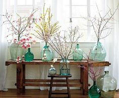A wedding inspired this spring look. Simple colored glass bottles filled with twigs. Can do the blue dye for glass thing. Spring Branch, Sweet Home, Sweet Sweet, Deco Floral, Floral Design, Design Design, Vintage Bottles, Vintage Wine, Home And Deco