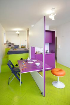 Tamka Apartment, a 231 sq. foot Warsaw apartment for a divorced man who wanted a weekend retreat where he could hang out with his son.  Love the colors!