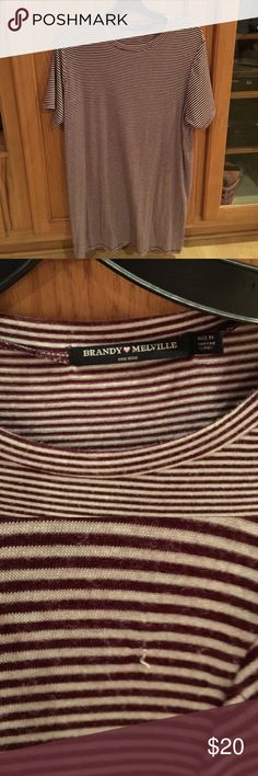 Brandy Melville t-shirt dress  Brandy Melville t-shirt dress . Previously loved ❤️. Great condition Tiny snag as shown in picture Brandy Melville Dresses