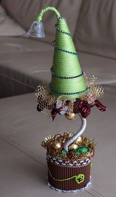 diy christmas topiary trees gold garlands small chocolates arrangements festive table decoration