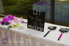 Let me take a selfie - Awesome idea for a wedding at Centennial Park in Munster, Indiana. The sticks actually had a button on them that connected via bluetooth