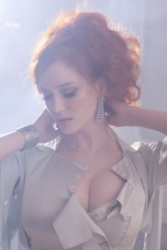 Who is redhead lady in roomstore tv commercials think, that