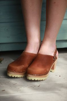 Lotto's brown oiled nubuck tractor sole clogs.