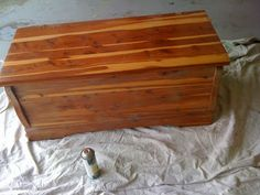 old cedar chest redon into a cushioned storage chest.  I have pretty much the exact boring chest in my bedroom right now--it needs this redo!