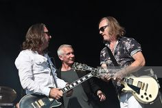 Ben Matthews, Danny Bowes and Luke Morley of Thunder perform on stage on day 2 of High Voltage Festival at Victoria Park on July 24, 2011 in London, England.