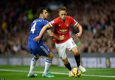 Adnan Januzaj skips past Chelsea's Cesc Fabregas, who can find no way to stop him except by pulling the young winger down