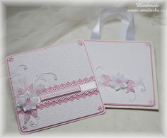 Big pink wedding card with embossed paper and satin flower.