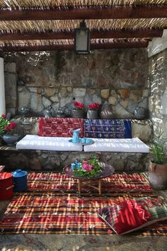 Lovely patio space, rugs, stone seat with cushions