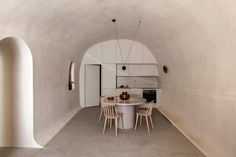 The vaulted forms and underground caves of an old Santorini house have been converted into two holiday residences in Fira by Kapsimalis Architects. Santorini House, Santorini Island, Fira Santorini, Interior Design Minimalist, Rooftop Lounge, White Building, Built In Storage, Lounge Areas, Greek Islands