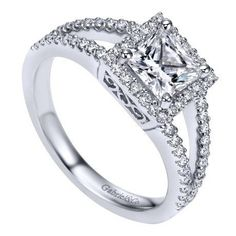 14k white gold 1.32cttw princess cut halo diamond engagement ring with prong set side diamonds and split shank design for a 1ct princess cut center. A square ha