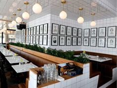 """Described as an """"Americanized French diner,"""" Foiegwa features white tiled walls framed by cappuccino-brown banquettes."""