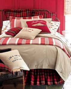 Classic red and black tartan combined with red and cream for a cozy bedroom look. our room needs some color.