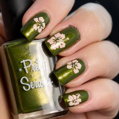 Hawaiian nails using Pretty Serious Blood of Knossos as the base and Bundle monster BM313, Moyou tropcial 4 and Kitty 2. Peach stamping polish is from Mundo de unas. Aussie Indie Polish