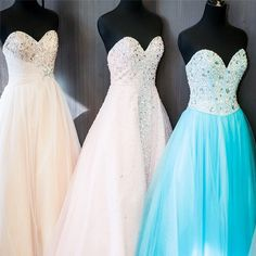 Go big or go home! These bedazzled ball gowns (Styles DB40, G170, & P1637) are the perfect way to make a statement on #promnight! #davidsbridal #prom2014