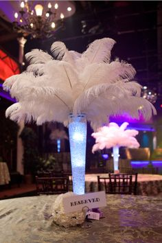 Ostrich feather centerpiece, feather centerpiece, lighted vase, varsity theatre