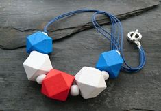Red, white and blue chunky wooden geometric necklace Wooden Bead Necklaces, Wooden Beads, Polygon Shape, Geometric Necklace, Organza Gift Bags, White Beads, Handmade Jewellery, Red And White, Art Projects