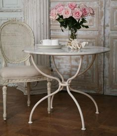 I want a screened-in porch with this cute cafe table and chairs. The roses are optional. :)