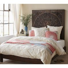 Bed and bedding. Textured headboard with color pop bedding.