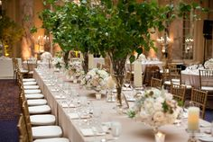 greenery centerpieces with flowers in lower containers