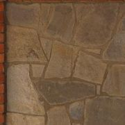 How to install a stone veneer over tile fireplace