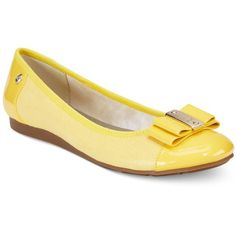 Anne Klein Sport Aricia Flats ($69) ❤ liked on Polyvore featuring shoes, flats, yellow, anne klein, flat heel shoes, flat shoes, flat pumps and yellow flats