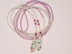Swarovski Crystal, seed bead lariat necklace, pink, white, fuscia, L79. $ 56.00, via Etsy.