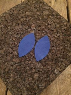 These blue leather earrings are gorgeous. They are a bright royal blue and are 4.75 long and are mounted on silver filled nickel free hooks.