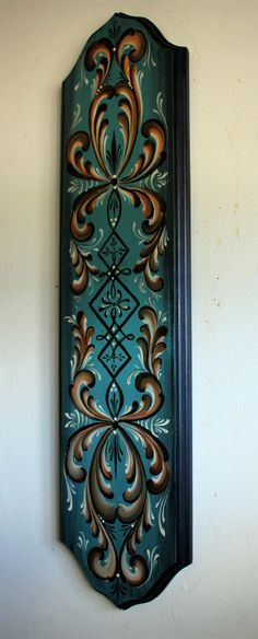 Beautiful Norwegian Rosemaling done in Oppdal Style. This bass wood plaque… Norwegian Rosemaling, Scandinavian Folk Art, Wood Plaques, Blue Backgrounds, Candle Sconces, Door Handles, Red And White, Wall Lights, Things To Come