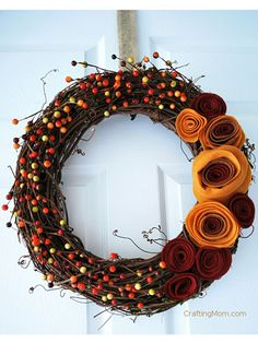 Coming up Roses: Make this colorful wreath for less than $10! Start by downloading this rosette template to cut swirl shapes out of felt. Tightly roll the ends of each flower together and secure with double-sided tape. Arrange your rosettes on a grapevine wreath and attach with a hot glue gun. Extra credit: Add sprigs of fall berries to complete the look.