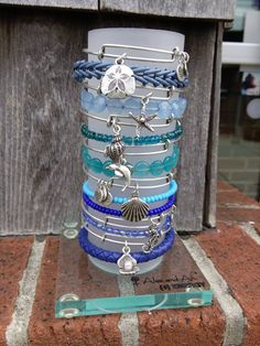 The beach-lover stack, featuring beaded bangles and wraps in shades of blue and teal.