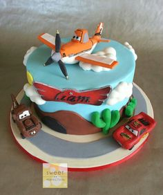 Planes & Cars cake! Gumpaste / fondant Dusty plane topper along with a small Lightning McQueen & Mater on the board.