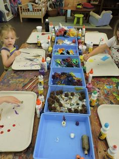 Working on collage art. The children are provided with a large array of scrap materials with which to create one of a kind works of art - Discovery Early Learning Center ≈≈