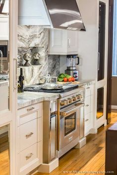 The Wolf Range Stove Has Stainless Knobs (opposed To The Iconic Red) To  Keep The Subtle Pallet Of The Kitchen In Tact.