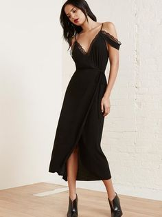 Bedroom dressing - it's a thing. This is a lace-trimmed, relaxed fitting wrap dress that hits below the knee.