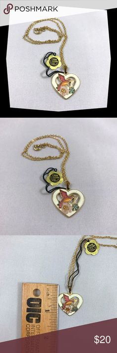 """NWOT Vintage Cloisonne Hummingbird Necklace A very sweet cloisonné hummingbird pendant from the 1970's. The heart shape pendant depicts a hummingbird drinking from flowers. The heart is a creamy white w/ gold toned metal backing. Pendant is hung from a gold tone cable chain.  A wonderful gift for a friend or to treat yourself! Has original tag stating it is genuine cloisonné.  Measurements: Necklace: 16""""  Pendant  Length: 1"""" Width: 15/16""""  **15% off 2 or more items! Discounts ⬆️ as number of…"""