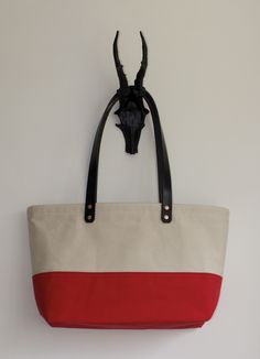 Riva: Large beige & red canvas tote with full grain black English leather handles and solid copper rivets.